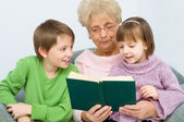Grandmother reading a book — Stock Photo