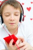 Kid listening to the music — Stock Photo
