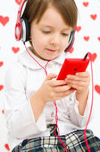 Kid listening to the music — Stock Photo