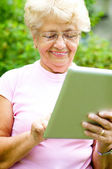 Senior woman using tablet — Stock Photo