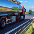 Stock Photo: Mirroring landscape chrome tank truck
