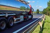 Mirroring the landscape chrome tank truck — Stock Photo