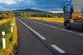 Asphalt road through the fields towards the horizon — Stock Photo
