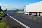 Landscape with road and truck — Stock Photo