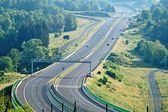 The highway between forests in the landscape — Stock Photo