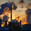 Stock Photo: Chimneys and dark smoke over chemical factory at sunset