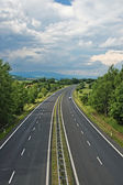 Rural landscape with a highway — Stock Photo
