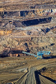 The wall surface mine with exposed colored minerals — Stock Photo