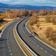 Landscape with highway, the highway ride three cars — Stock Photo #41768523