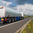 A tanker truck on the highway leading through the countryside — Stock Photo #49775115