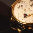 Постер, плакат: Golden colour luxury chronometer macro