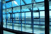 Blue window frame in airport — Stockfoto