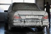 Car washing white foam on a Mercedes Benz — Stock Photo