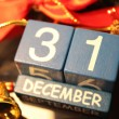31 December date cubes and red ribbon — Stock Photo #37632877