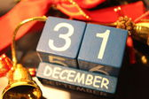 31 December date cubes and red ribbon — Stock Photo