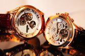 Two golden luxury chronometers (macro) — Stock Photo