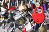 Red heart and other locks outdoors — Foto Stock