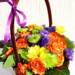 Stock Photo: Bright flower arrangement (ikebana) in basket