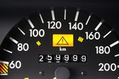 Lucky figures and warning sign at speedometer — Foto Stock