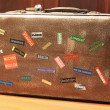 Country tag stickers on travel suitcase — Stock Photo #23588449
