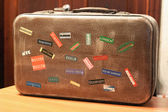 Country tag stickers on a travel suitcase — Stock Photo