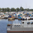 Stock Photo: Many motor boats and small yachts near piers