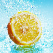 Stock Photo: Lemon in water