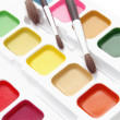 Stock Photo: Paints and brushes