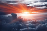 Sunset above the clouds — Stockfoto