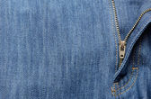 Jeans background with open zipper — Stock Photo