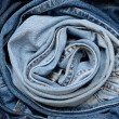 Stock Photo: Rolled jeans