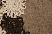 Brown fabric with flower edge — Stock Photo