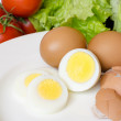 Stock Photo: Boiled eggs with vegetables