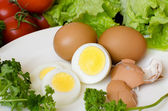 Boiled eggs on a white plate — Stock Photo