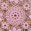 Crochet lace on a wooden surface — Stock Photo