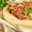 Pie with spinach, cheese and tomatoes - Stock Photo