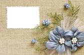 Background with a flower arrangement and a card — Stock Photo