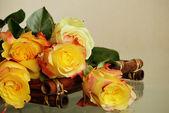 Roses on a bamboo tray — Stock Photo