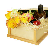 Roses and wine as a gift — Stock Photo