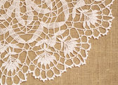Lace on canvas — Stock Photo
