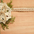 Stock Photo: Background and crochet lace and thujbranches