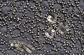 Embroidered fabric with beads — Stock Photo