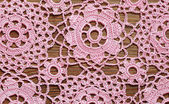 Crochet lace on a wood — Stock Photo