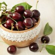 Stock Photo: Sweet cherries in a wooden bowl