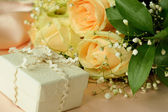 Gift on floral background — Stock Photo
