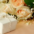 Stock Photo: Small gift and roses
