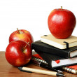 Notebooks, pens and apples on table — Stock Photo #30140941