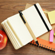 Notebooks, pens, stickers and apple — Stock Photo #30140951