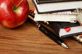 Notebooks, pen and apple — Stock Photo