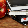 Notebooks, pen and apples — Stock Photo #30156229